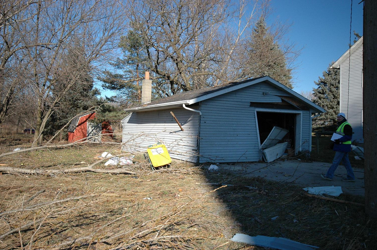 Garage damage with 2x4 thrown into side (Caledonia)