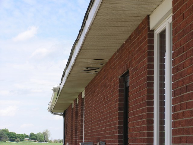 Soffit damage to the west side of the Purdue Agricultural Extension Office.
