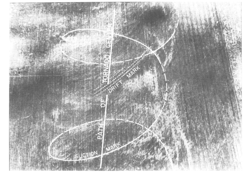 Aerial photograph of typical suction and drift marks left by a tornado on an unplowed field.